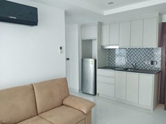 Condominium for sale Wong Amat showing the living and kitchen areas