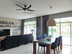 House for sale Huay Yai Pattaya showing the dining and living areas with pool view
