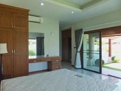 House for sale Huay yai Pattaya showing themaster bedroom with garden view