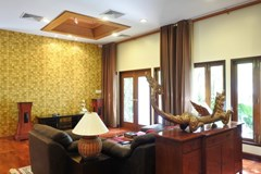 House for sale at Na Jomtien showing the living room with pool view