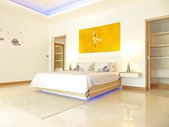 House for Sale at The Vineyard Pattaya showing the master bedroom with walk-in wardrobes