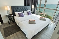 Condominium for sale Wongamat Pattaya showing the master bedroom with sea view