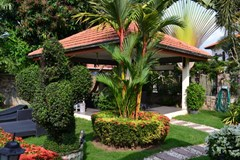 House for sale Pattaya Mabprachan showing the sala and garden