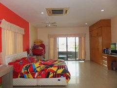 House for Sale Mabprachan Pattaya showing the master bedroom with furniture