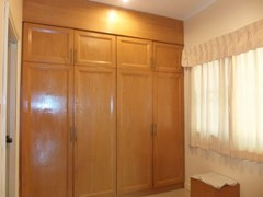 House for Sale Mabprachan Pattaya showing the master bedroom walk-in wardrobes
