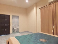 House for sale WongAmat Pattaya showing the master bedroom suite