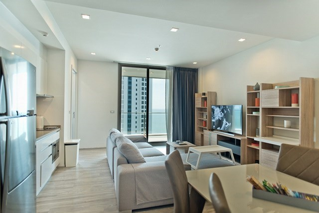 Condominium for sale Wongamat Pattaya showing the dining and living areas