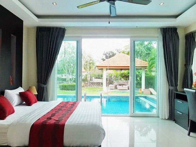 House for rent Mabprachan Pattaya showing the master bedroom with pool view