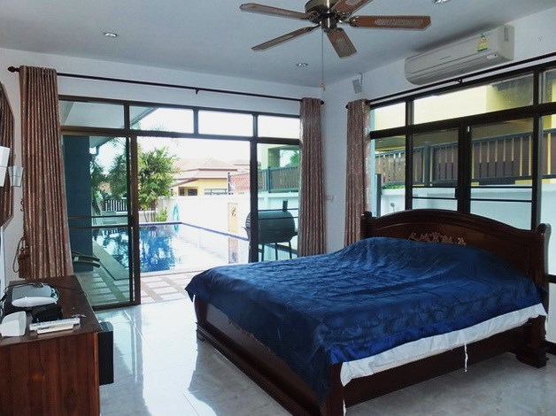 House for sale Pattaya Bangsaray showing the master bedroom and pool view